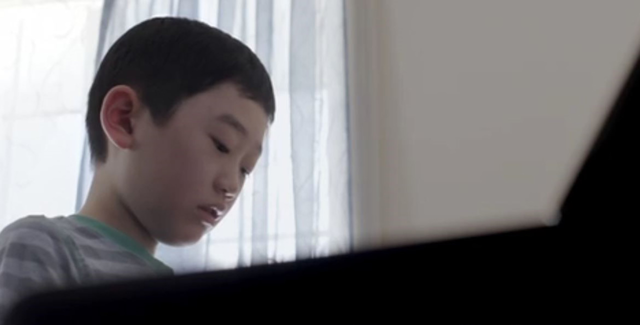 Child plays the piano