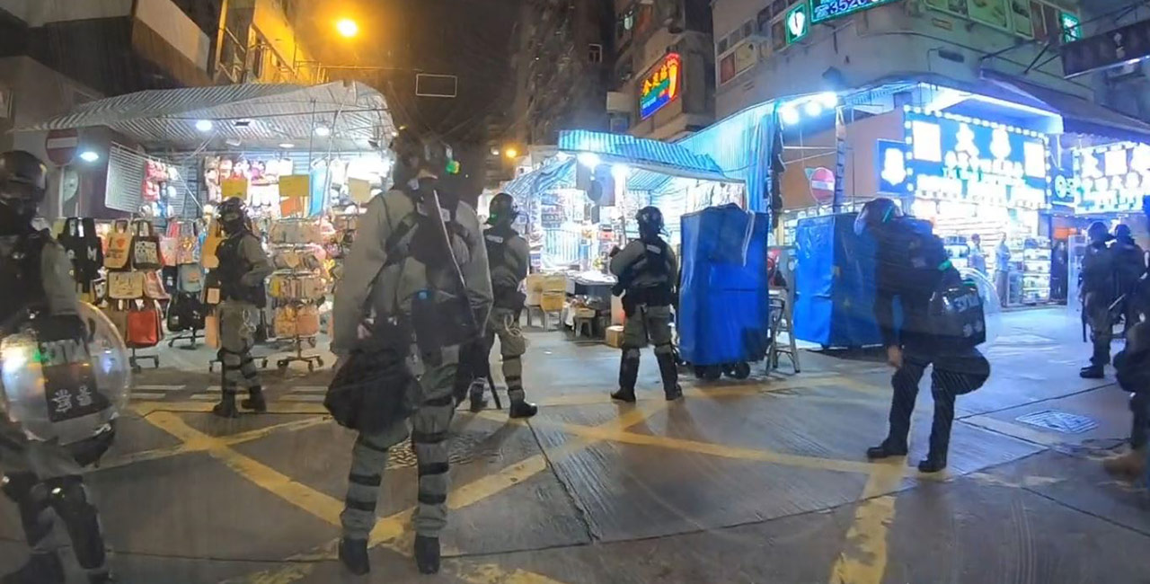 A scene from Hong Kong protests with police in riot gear